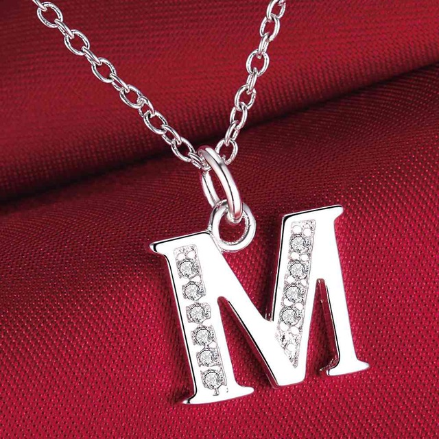 صورة صور حرف m , حرف ال m كتب بطريقه مزخرافه مصورة